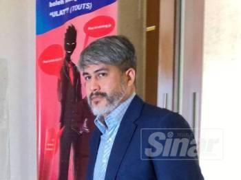 Ahmad Izhan ketika hadir hari kesembilan perbicaraan ke mambabitkan Ahmad Zahid yang menghadapi 47 pertuduhan melibatkan dana Yayasan Akalbudi.