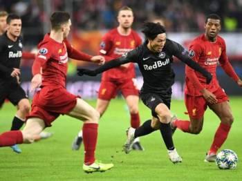 Kelibat Minamino berjaya mencuri perhatian ketika Salzburg berdepan Liverpool dalam kedua-dua aksi peringkat kumpulan Liga Juara-Juara musim ini. - Foto AFP