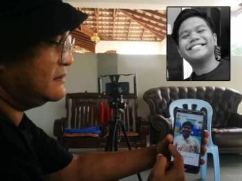 Azahari menunjukkan gambar Muhammad Farhan Fudhail di telefon bimbitnya.