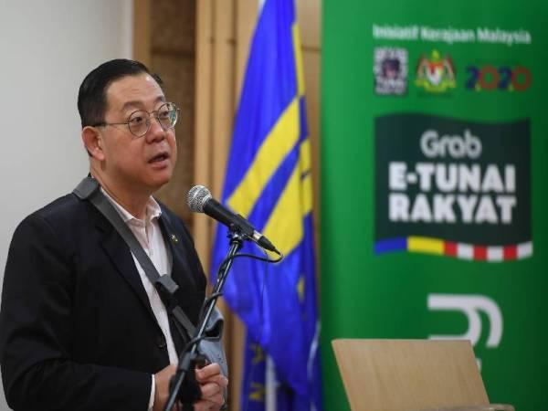 Lim Guan Eng ketika sidang media mengenai Pengumuman Pelancaran Inisiatif e-Tunai Rakyat di Kementerian Kewangan. -Foto Bernama