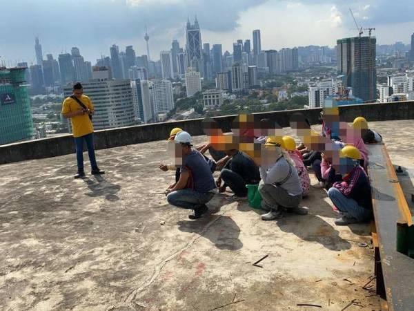 Antara warga asing yang ditahan dalam Ops Kutip di kawasan tapak pembinaan di Jalan Ampang, Kuala Lumpur kelmarin.