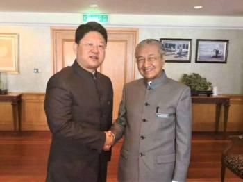 Dr Mahathir bersama Bai Tian