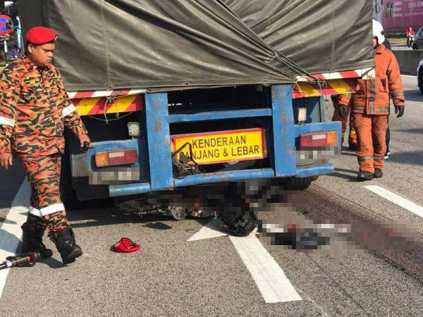 Mangsa yang parah maut di tempat kejadian selepas digilis dan diseret sejauh 25 meter dalam kejadian pagi tadi.