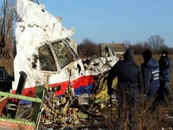 Serpihan bangkai MH17 yang ditemui berhampiran perkampungan Hrabove di wilayah Donetsk, timur Ukraine. Foto: Agensi
