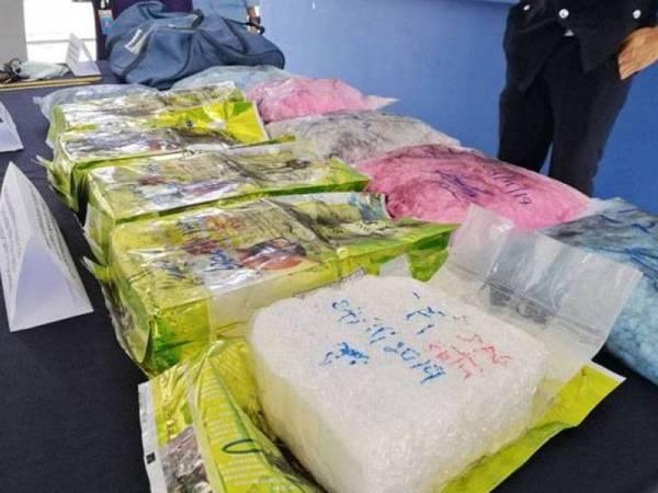 Kejayaan rampasan dadah jenis syabu seberat 5.2 kilogram serta pil ekstasi oleh polis Selangor.