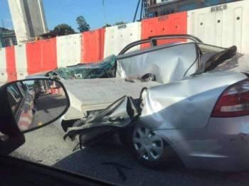 Seorang wanita cedera apabila satu bongkah konkrit pembinaan Lebuhraya Shah Alam-Ulu Kelang (SUKE) jatuh menghempap kereta yang dinaikinya, petang tadi.