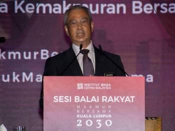 Muhyiddin berucap pada Majlis Sesi Balai Rakyat Makmur Bersama Kuala Lumpur 2030 di Pusat Konvensyen Kuala Lumpur hari ini. - Foto Bernama