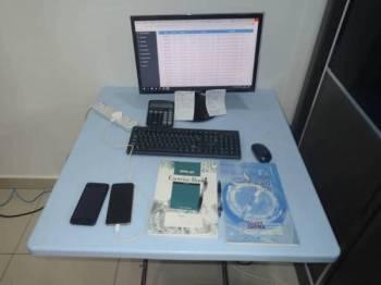 Antara barangan yang ditemui dalam sebuah pangsapuri di Butterworth yang dijadikan pusat operasi judi dalam talian.