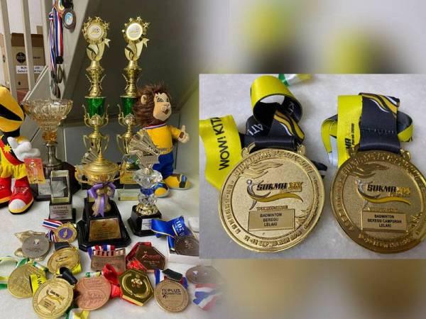 Antara trofi dan medal dimenangi Aaron. - Foto FB Khoo Poay Tiong