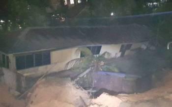 Tanah runtuh di belakang rumah teres dua tingkat di Kemensah Height pada Jumaat.